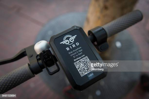 An unlocking device with a quick response code is seen on the handlebars of a Bird Rides Inc shared electric scooter in San Francisco California US...