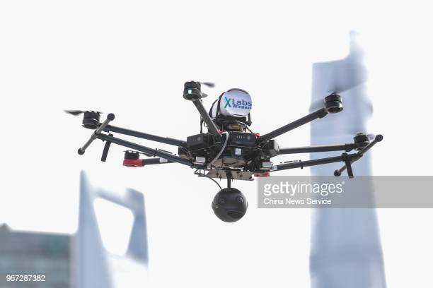 An unmanned aerial vehicle carrying a 5G communication technology module takes off along the Huangpu River on May 10 2018 in Shanghai China Shanghai...