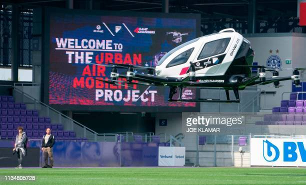 An unmanned Air Taxi EHANG 216 takes off during a press preview of FACC AG on Urban Air Mobility at Generali Arena in Vienna Austria on April 4 2019...