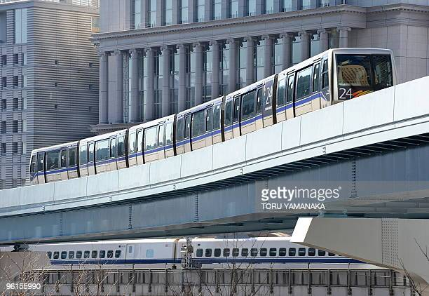 An unmanned automatic train of the Yurikamome line which links Shimbashi in downtown to the waterfront area over a distance of about 15km runs past...
