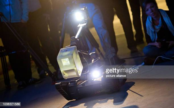 An 'unmanned ground vehicle' collects fingerprints with a new optic process at a fictitious crime scene during a demonstration at the University of...