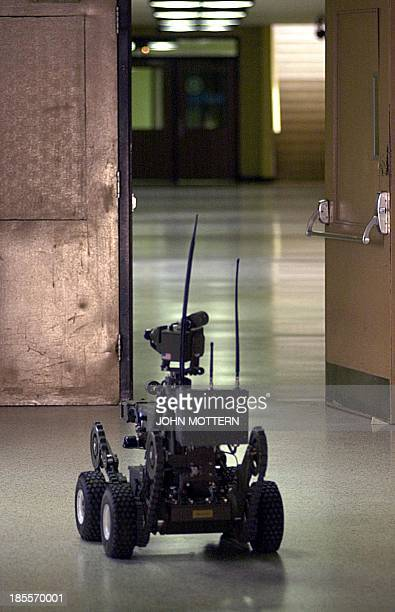 An unmanned remote State Police robot assists the New Bedford Special Reaction Team and bomb sniffing dogs inside the New Bedford High School 25...
