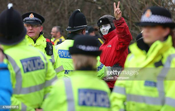 An unnamed antifracking protester signals to supporters after being cut free from a 'lockon' near the Barton Moss exploration facility on March 6...