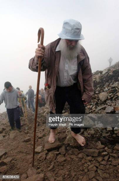 An unnamed pilgrim during his barefoot ascent of the 765M Croagh Patrick in Co Mayo Around 20000 people are expected to complete this year's...
