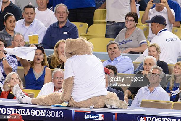 An unoffical dancing bear mascot performs at Game Three of the National League Championship Series at Dodger Stadium on October 14 2013 in Los...