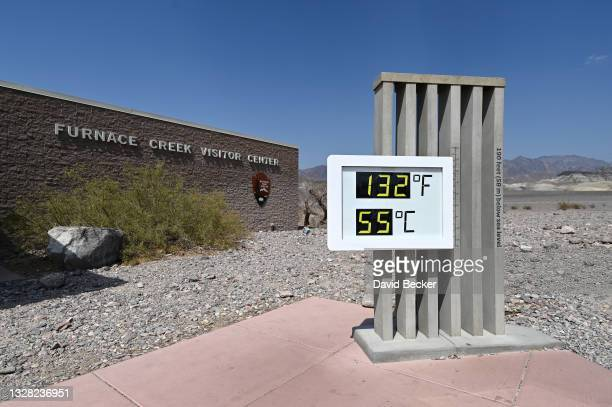 An unofficial thermometer reads 132 degrees Fahrenheit/55 degrees Celsius at Furnace Creek Visitor Center on July 11, 2021 in Death Valley National...