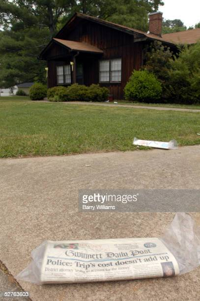 An unopened newspaper lies outside the house of John Mason the fiance of the runaway bride Jennifer Wilbanks May 5 2005 in Duluth Georgia Wilbanks'...