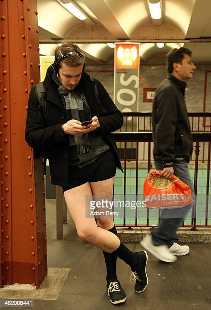 An unsuspecting passenger passes a participant of the No Pants Subway Ride in Alexanderplatz station on January 12, 2014 in Berlin, Germany. The...