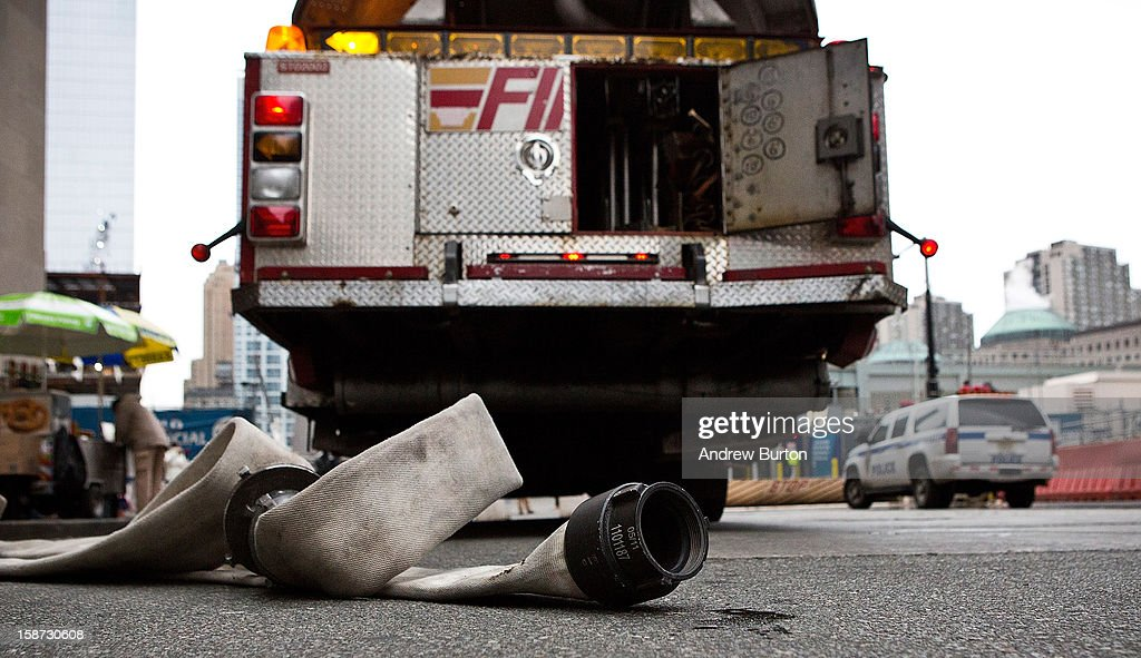 An unused fire hose sits next to fire truck after firemen responded to a two-alarm fire at the World Trade Center on December 26, 2012 in New York City. The fire, which broke out in the construction trailers surrounding the World Trade Center building, was quickly contained.