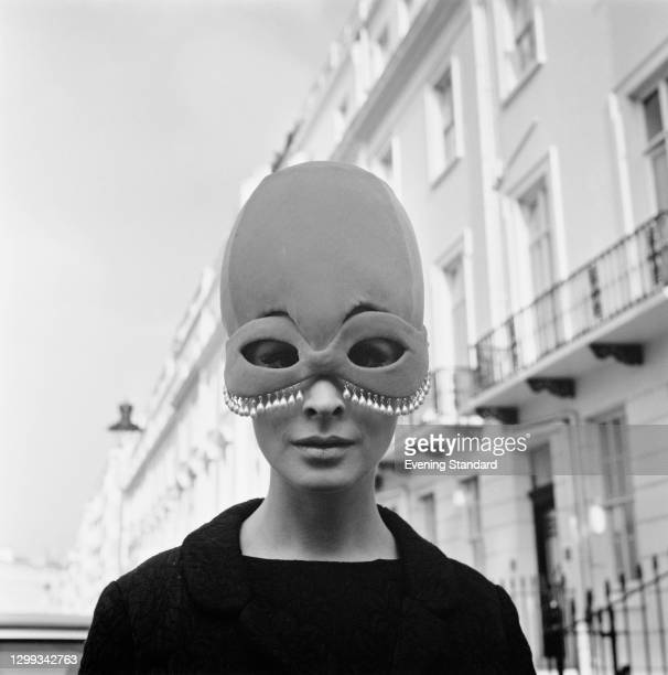 An unusual domed hat incorporating an eye mask with pearl bead trim, UK, October 1966.