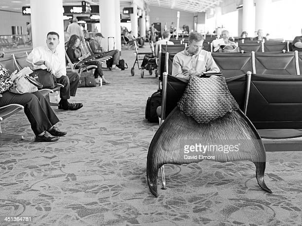 CONTENT] An unusual scene featuring a mermaid fin spotted at a departure gate in the Charlotte Douglas International Airport
