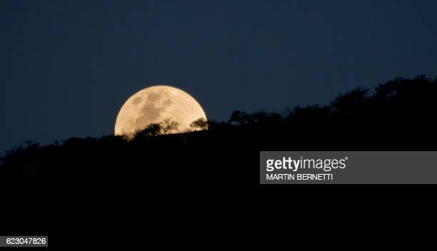 An unusually large and bright Moon the closest 'supermoon' to Earth in 68 years adorns the night sky in Santiago on November 13 2016 / AFP / MARTIN...