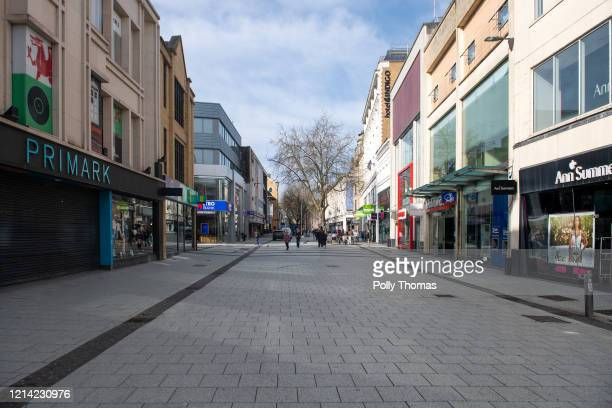 An unusually quiet Queen Street in the city centre on March 23, 2020 in Cardiff, United Kingdom. Coronavirus pandemic has spread to at least 182...