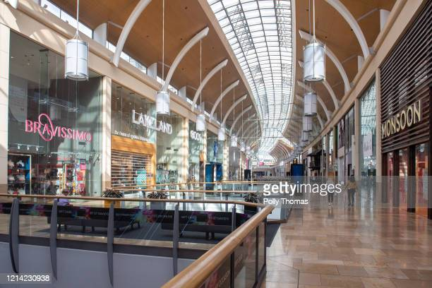 An unusually quiet St Davidu2019s shopping centre where many shops have closed on March 23 2020 in Cardiff United Kingdom Coronavirus pandemic has...