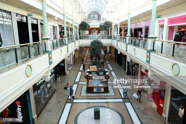 An unusually quiet Trafford Centre shopping complex is seen as the UK adjusts to life under the Coronavirus pandemic on March 19, 2020 in Manchester,...