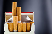 An up close view of a package of several cigarettes