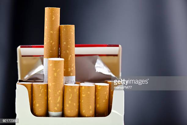an up close view of a package of several cigarettes  - cigarette stock pictures, royalty-free photos & images
