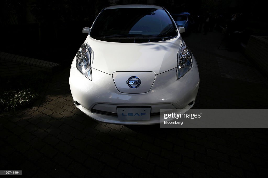 An updated Nissan Leaf electric vehicle (EV) produced by Nissan Motor Co. is seen during a news conference in Japan, Tokyo, on Tuesday, Nov. 20, 2012. Nissan Motor Co., Japan's second-largest carmaker, introduced a cheaper version of the Leaf electric vehicle to lure cost-conscious buyers as sales of the original model lag behind the company's target. Photographer: Kiyoshi Ota/Bloomberg via Getty Images