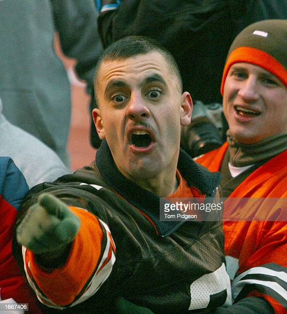 An upset Cleveland Browns fan berates Carolina Panther players as they exit the field after a game on December 1 2002 at Browns Stadium in Cleveland...