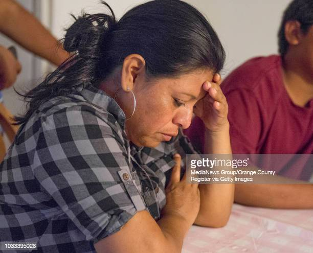 An upset Griselda Lopez left mother the 14yearold boy shown cell phone video footage being arrested by a Santa Ana school police officer listens as...