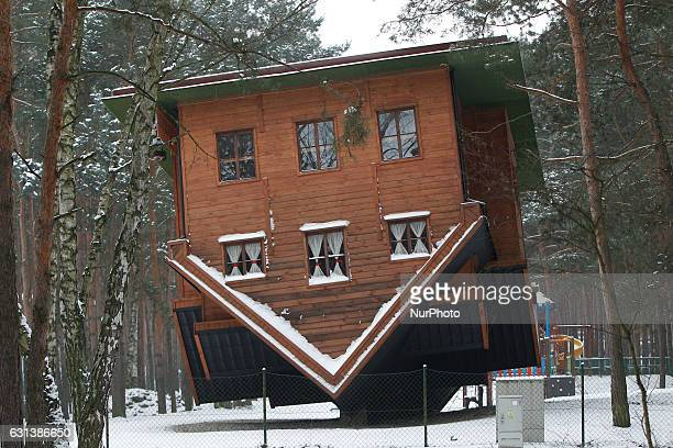 An upside down house is seen in a recreational area in Bydgoszcz Poland on 9 January 2017 Temperatures in the central part of Poland have reached...