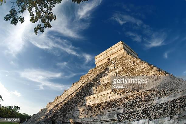 An upward shot of the Mayan pyramid in daylight