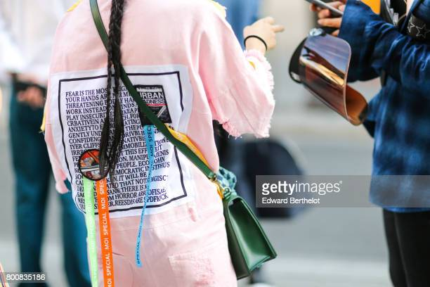 An Urban Madness pink jacket with a printed paragraph is seen outside the Hermes show during Paris Fashion Week Menswear Spring/Summer 2018 on June...