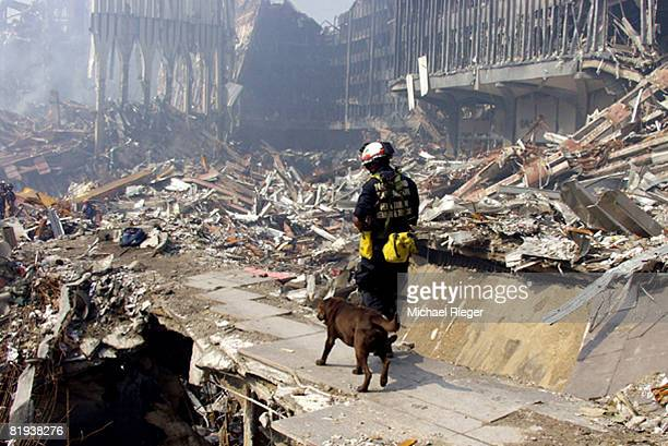 An Urban Search and Rescue crew member from Washington state searches through the rubble for survivors following the terrorist attacks on the World...