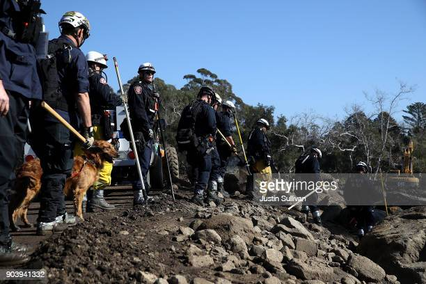 An urban search and rescue team prepares to search a neighborhood that was destroyed by a mudslide on January 11 2018 in Montecito California 17...