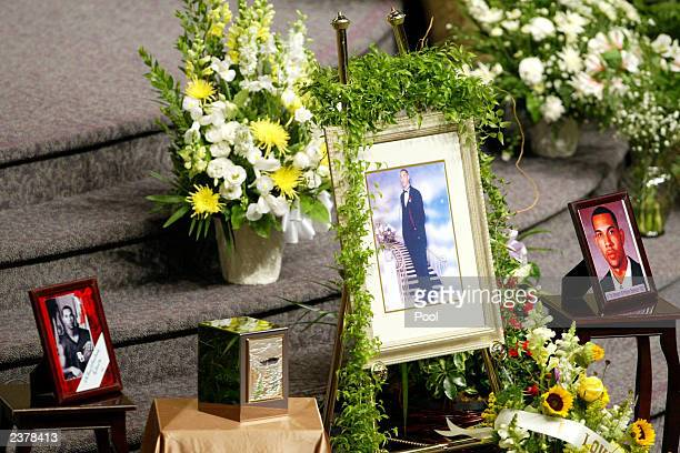 An urn containing Patrick James Dennehy's ashes photos and flowers were the centerpiece at a memorial services for Dennehy August 7 2003 at the...