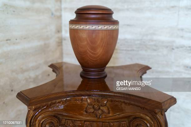 An urn sits on a table at the San Jose mortuary in Burgos in northern Spain on April 16, 2020. - Employees of the Burgos mortuary travel four times a...
