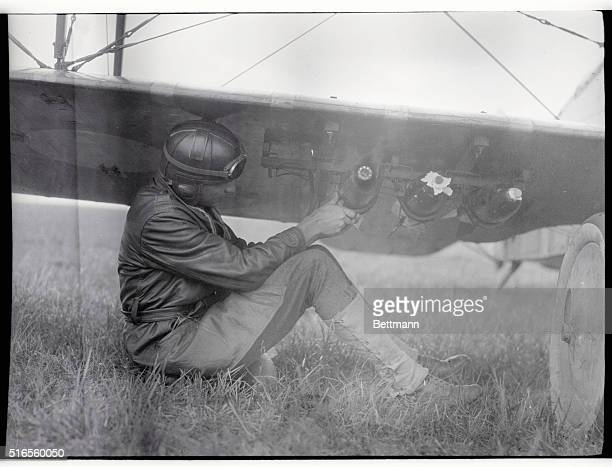 An US Air Force pilot attaches bombs to the wings of his plane during World War I