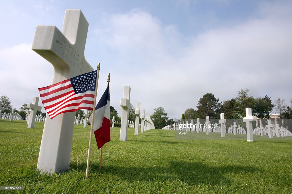 An US and a French flag are planted by a stele at the American cemetery in Colleville-sur-Mer, Normandy, western France, on June 6, 2010, during a commemoration of the 66th anniversary of the D-Day Allied landings on the beaches of Normandy. More than 45,000 Allied soldiers, including 29,000 Americans, were killed during Operation Overlord, which saw the opening of a second front on mainland Europe and led to the liberation of France.