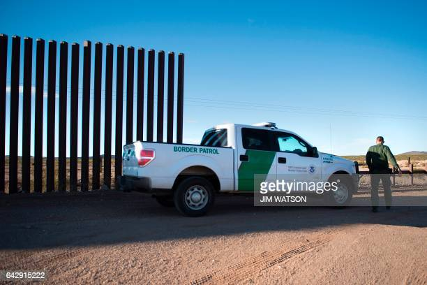 An US Border Patrol agent checks the area near the border fence in Columbus New Mexico on February 19 on the US/Mexico border Attention Editors this...