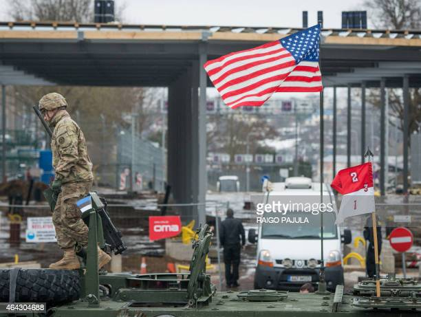 An US flag blows at a tank in front of an EstonianRussian border point during a military parade to celebrate 97 years since first achieving...