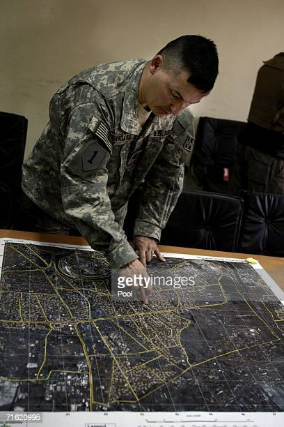 An US Infantry officer studies a map after Iraqi BG Abdel Karim Abdel Rahman Yussef commander 6th brigade 2nd Iraqi national police and US commander...