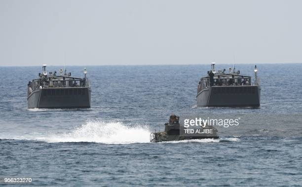 An US marines assault amphibious vehicle takes the lead of Philippine marines landing ships as they simulate an amphibious landing as part of the...