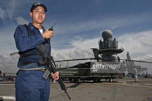 An US Navy soldier stands guard near the US navy ship USS Blue Ridge at Tanjung Priok port during a two day visit in Jakarta, 08 March 2007. USS Blue...