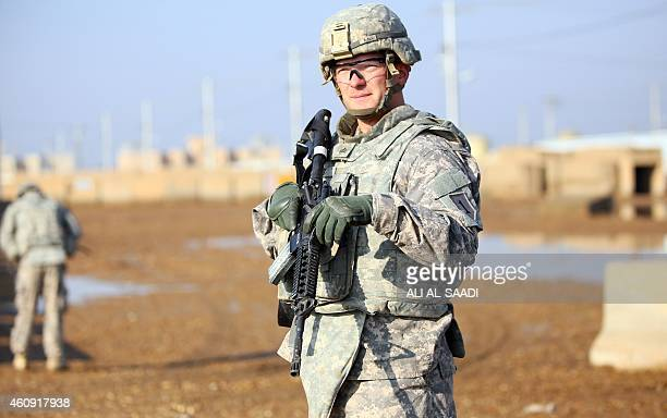 An US soldier stands at the Taji base complex which hosts Iraqi and US troops and is located thirty kilometres north of the capital Baghdad on...