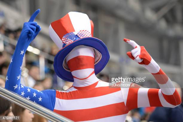 An Us supporter cheers before the Men's Ice Hockey Quarterfinals match between the USA and the Czech Republic at the Shayba Arena during the Sochi...