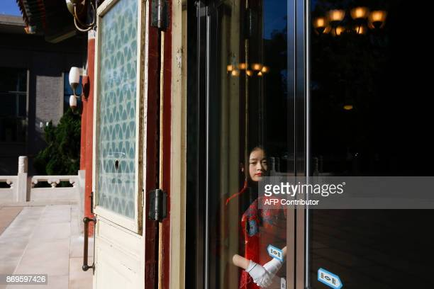 An usher waits for the arrival of Microsoft cofounder and philanthropist Bill Gates at the Zhongnanhai government compound in Beijing on November 3...