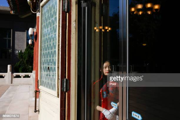 An usher waits for the arrival of Microsoft cofounder and philanthropist Bill Gates at the Zhongnanhai government compound in Beijing China November...