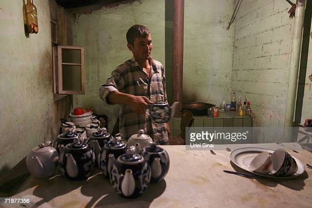 An Uzbek man prepares pots of tea in a chai khana Uzbek for tea house on August 15 2006 in Kamchik in the central Asian country of Uzbekistan Fifteen...