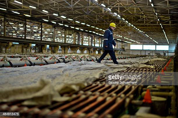 An view inside the copper tankhouse of Aurubis AG which produces copper cathodes from the copper anodes an employee controls the refinement process...