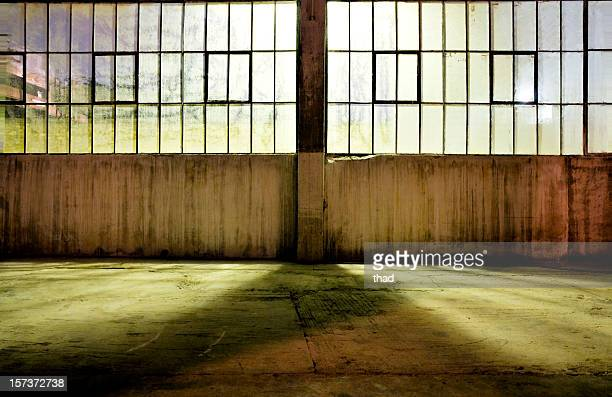 an view of an old warehouse at night  - abandoned stock pictures, royalty-free photos & images