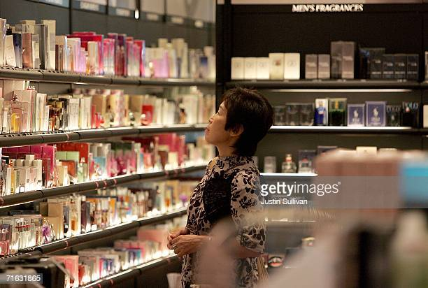 An woman browses through perfume at a Sephora cosmetics store in the international terminal at San Francisco International Airport August 11, 2006 in...