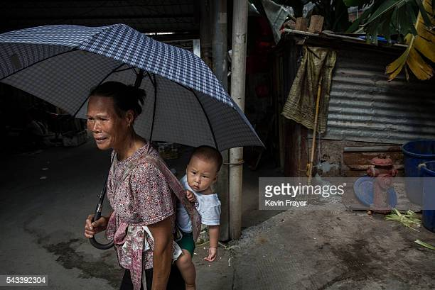 An woman carries her grandson on Shazai Island where the Sun YatSen UniversityMichigan University Joint Center of Vector Control for Tropical Disease...