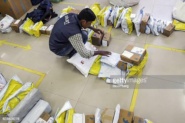 An worker sorts packages at a Flipkart Online Services Pvt office in the Jayaprakash Narayan Nagar area of Bengaluru India on Wednesday Oct 26 2016...
