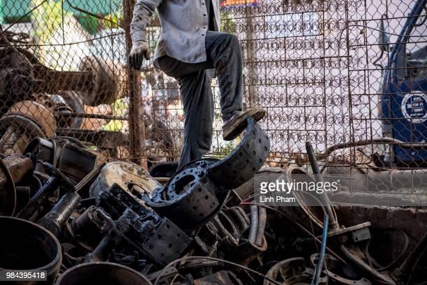An worker tears apart truck parts a truck scrapyard on June 7 2018 in Dong Van Village Yen Lac District Vinh Phuc Province Vietnam Vietnam has...