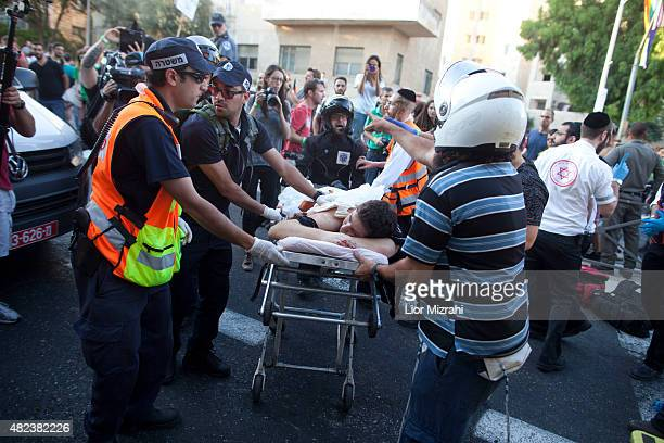An wounded an Israeli man receives treatment during the Gay Pride Parade on July 30 2015 in Jerusalem Israel At least six people were stabbed at...